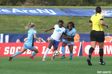 Boston Breakers forward Ifeoma Onumonu (22) takes on Sky Blue FC players Nikki Stanton (7) and Kayla Mills (15)
