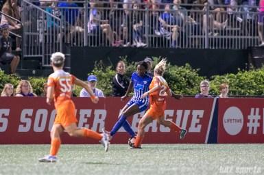 Boston Breakers forward Ifeoma Onumonu (22) takes on Houston Dash defender Camille Levin (22)