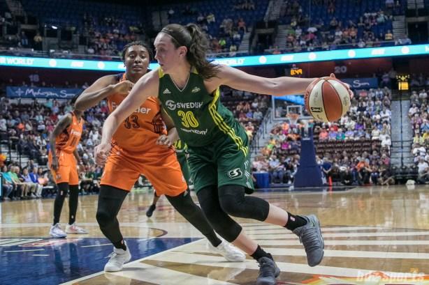 Seattle Storm forward Breanna Stewart (30) drives to the basket against former UCONN teammate Connecticut Sun forward Morgan Tuck (33).
