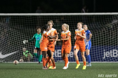 The Houston Dash celebrate their second goal of the game.