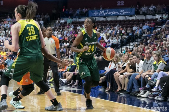 Seattle Storm guard Jewell Loyd (24) controls the ball for the Storm.