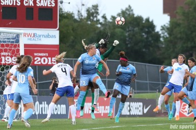 Boston Breakers goalkeeper Abby Smith (14) punches the ball away on a corner kick