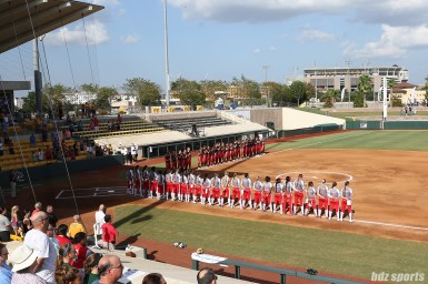 The Akron Racers and Scrap Yard Dawgs stand for the national anthem prior to their game on August 18, 2017.
