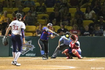 Chicago Bandits infielder Emily Carosone (15) makes contact with the ball