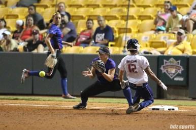 USSSA Pride outfielder Kelly Kretschman (12) beats the throw to third base
