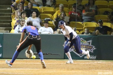 USSSA Pride catcher Chelsea Goodacre (77) runs it out to first base