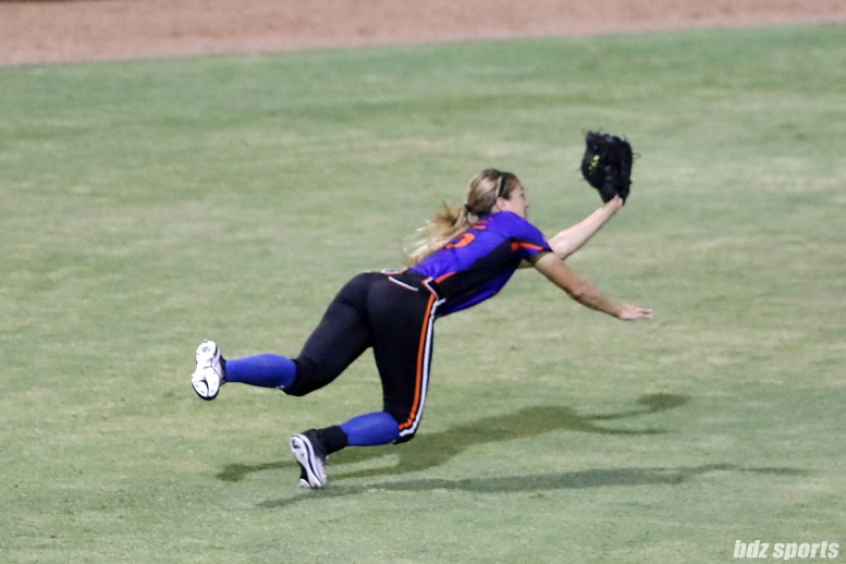 Chicago Bandits outfielder Brenna Moss (55) makes a diving catch