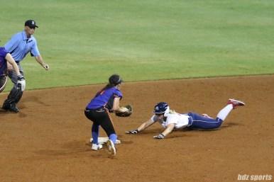 USSSA Pride first baseman Hallie Wilson (22) slides to steals second base