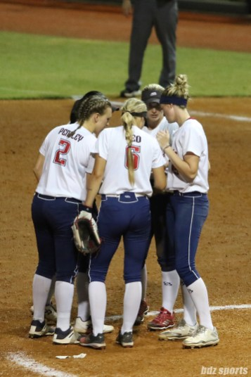 The USSSA Pride infield huddles together