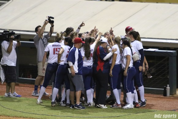 The USSSA Pride huddle at the end of the game