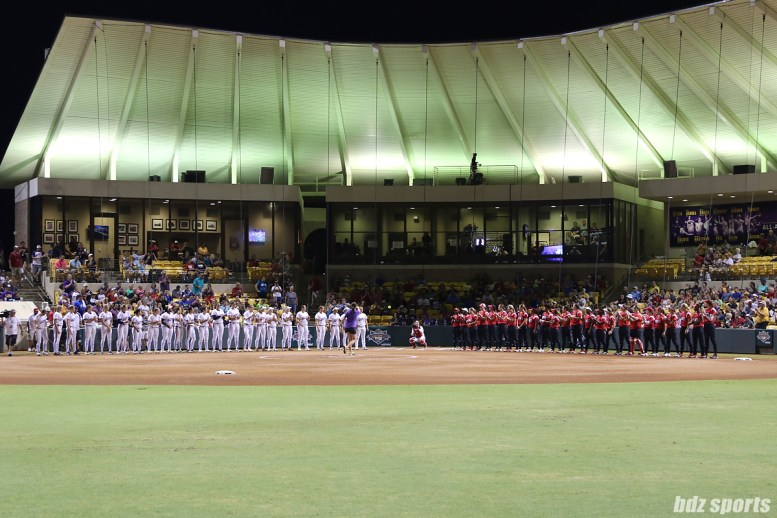 The USSSA Pride and Scrap Yard Dawgs line up as th first pitch is thrown before the start of NPF Championship Game 1.