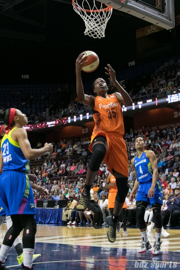 Connecticut Sun center Jonquel Jones (35) goes for the reverse layup against the Dallas Wings.