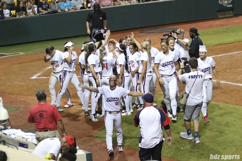 The USSSA Pride celebrate Shelby Pendley's 3-run homerun in the bottom of the 5th inning