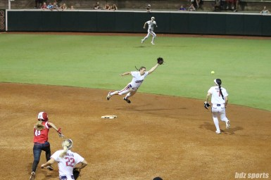 USSSA Pride shortstop Shelby Pendley (2) dives but is unable to come up with the ball