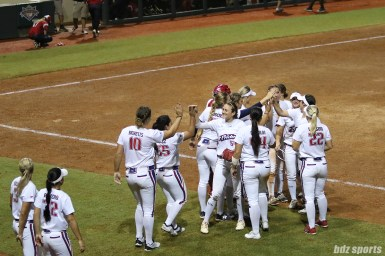 The USSSA Pride high five after closing out the top of the inning