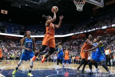 Connecticut Sun forward Alyssa Thomas (25) goes airborne to release a shot near the basket.