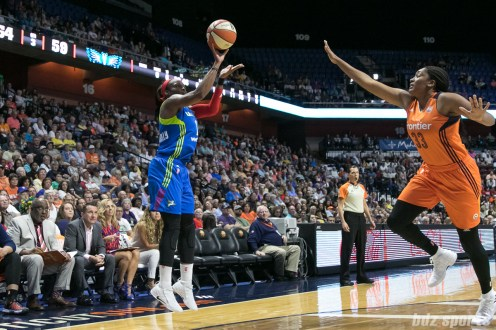 Dallas Wings forward Karima Christmas-Kelly (13) releases a 3-point shot.