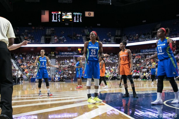 The Dallas Wings look to the referee after disagreeing with the call on the floor.
