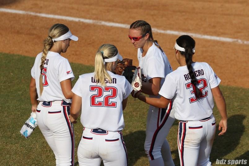 USSSA Pride infielders Courtney Ceo (6), Hallie Wilson (22), Shelby Pendley (2), and Sierra Romero (32) tap gloves before taking the field