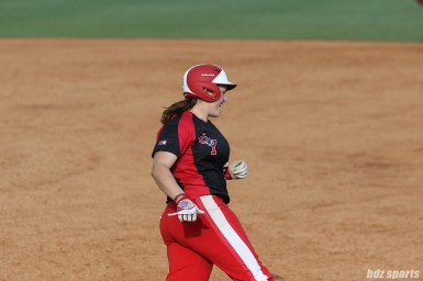 Scrap Yard Dawgs designated hitter Meagan May Whitley (13) is all smiles after hitting the ball out of the park