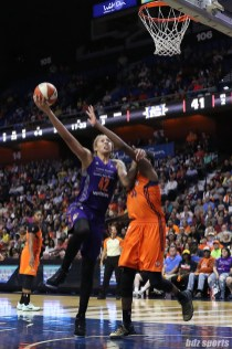Phoenix Mercury center Brittney Griner (42) goes for the hook shot