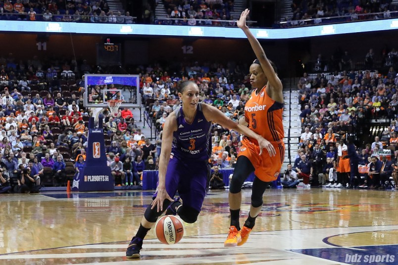 Phoenix Mercury guard Diana Taurasi (3) drives to the basket while being defended by Connecticut Sun guard Jasmine Thomas (5)