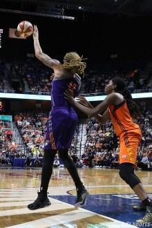 Phoenix Mercury center Brittney Griner (42) grabs the ball