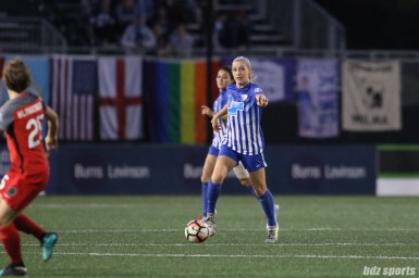 Boston Breakers defender Megan Oyster (4) controls the ball for the Breakers