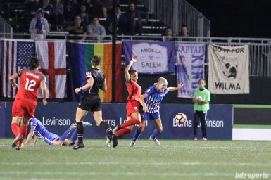 Portland Thorns FC forward Nadia Nadim (9) challenges Boston Breakers defender Megan Oyster (4) for the ball