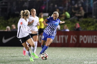 Boston Breakers forward Adriana Leon (19) takes on Sky Blue FC midfielder Nikki Stanton (7)