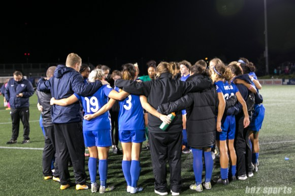 The Boston Breakers huddle at the end of the game