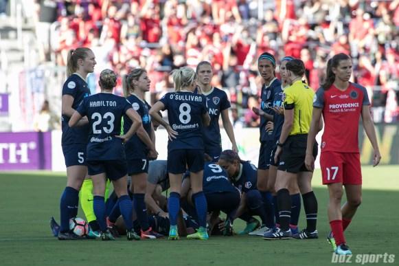 The North Carolina Courage huddle around injured teammate Taylor Smith