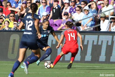 North Carolina Courage defender Jaelene Hinkle (15) takes on Portland Thorns forward Ashleigh Sykes (14)