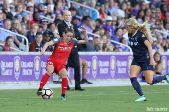 Portland Thorns FC defender Meghan Klingenberg (25) cuts the ball back as North Carolina Courage forward Makenzy Doniak (3) defends