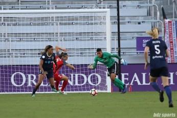 North Carolina Courage forward Jessica McDonald (14) and Portland Thorns FC goalkeeper Adrianna Franch (24) eye a loose ball in the box