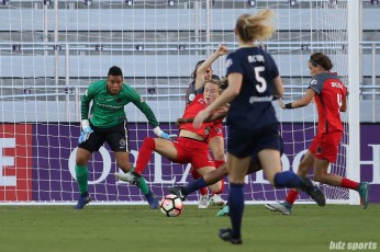 Portland Thorns FC defender Emily Sonnett (16) lunges to defend against a shot in the box