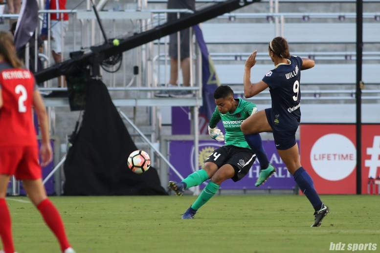 North Carolina Courage forward Lynn Williams (9) attempts to defend against a ball clear by Portland Thorns FC goalkeeper Adrianna Franch (24)