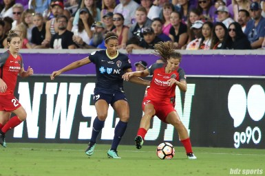Portland Thorns FC midfielder Tobin Heath (17) looks to shield North Carolina Courage forward Lynn Williams (9) off the ball