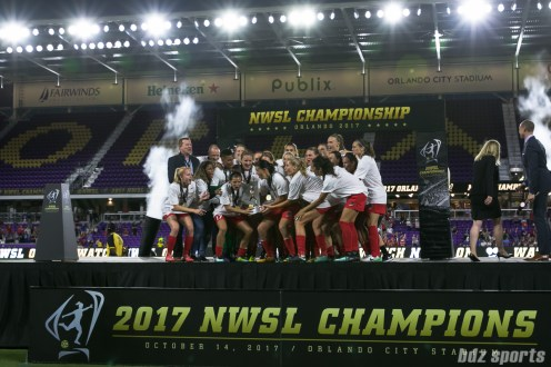 The Portland Thorns FC prepare to hoist the 2017 NWSL Championship trophy