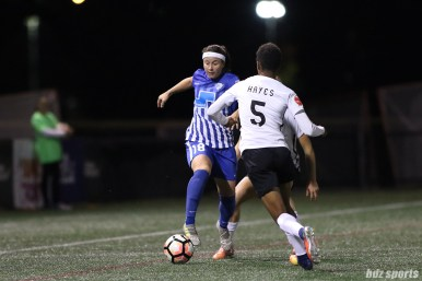 Boston Breakers forward Tiffany Weimer (18) looks to get past Sky Blue FC forward Maya Hayes (5)
