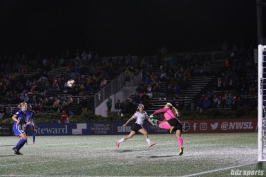 Sky Blue FC goalkeeper Caroline Casey (27) leaves the ground to push a shot away from danger