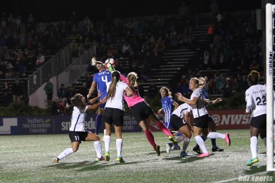 Sky Blue FC goalkeeper Caroline Casey (27) punches the ball away as Boston Breakers defender Megan Oyster (4) attempts to head the ball in