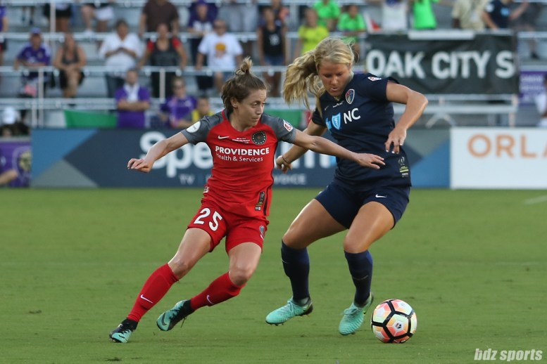 Portland Thorns FC defender Meghan Klingenberg (25) controls the ball against North Carolina Courage forward Makenzy Doniak (3)