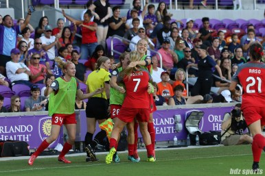 Portland Thorns FC midfielder Lindsey Horan (7) gets mobbed by teammates after scoring the game's opening and what would be lone goal