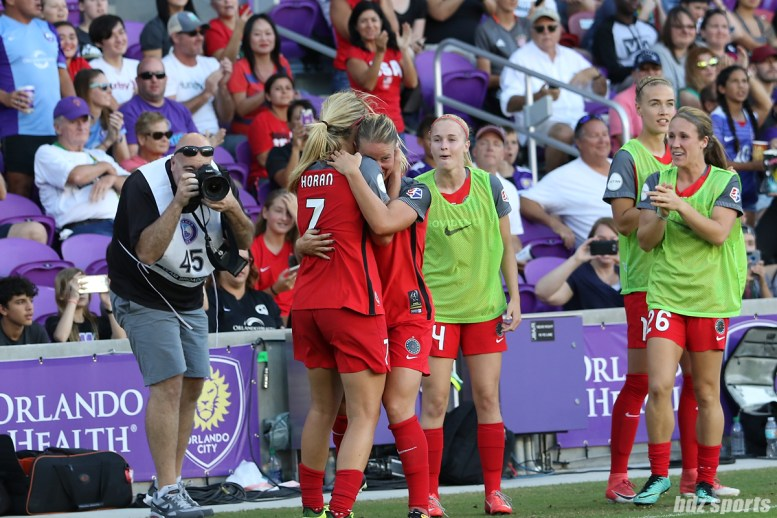 Portland Thorns FC midfielder Lindsey Horan (7) hugs teammate midfielder Amandine Henry (28), who will be not returning to the Thorns next season