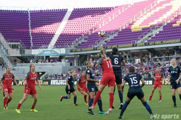 Portland Thorns FC midfielder Dagny Brynjarsdottir (11) and North Carolina Courage defender Abby Erceg (6) battle for the ball