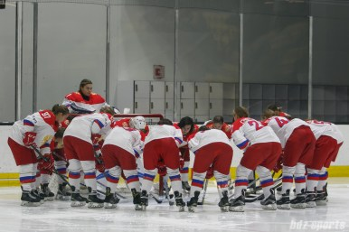 The Russian National Team huddles before the start of the game