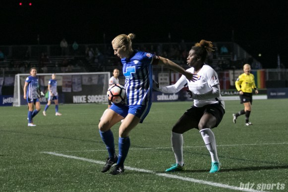 Boston Breakers forward Natasha Dowie (9) shields the ball from Sky Blue FC defender Mandy Freeman (22)