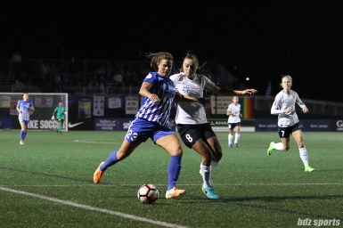 Boston Breakers forward Katie Stengel (23) prepares to take a shot on goal while being pressured by Sky Blue FC defender Erica Skroski (8)