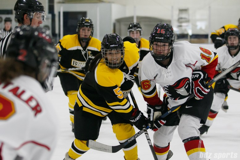 Boston Blades forward Michelle Ng (5) lines up against Calgary Inferno forward Sophie Shirley (16)
